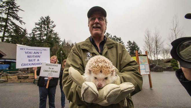 Whiskers the hedgehog predicts the Spring forecast along with curator Michael Illig at the Oregon Zoo.