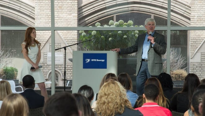 Gov. Rick Snyder welcomes and talks to summer interns at a lunch at the Blue Cross Blue Shield of Michigan building, June 23, 2014.