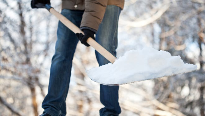 Tips to avoid snow shoveling injuries