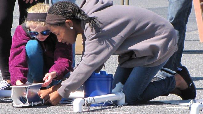 Middle school students race solar-powered cars at the Junior Solar Sprint in Harrington.