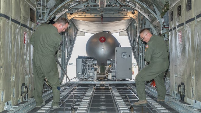 Aircrewmen in the 153rd Airlift Wing, Wyoming National Guard pull MAFFS equipment into the back of the C-130. the Nevada Air National Guard will operate a similar piece of equipment from Reno.
