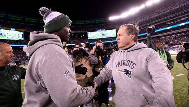 Jets coach Todd Bowles and Patriots coach Bill Belichick, right, shake hands after New England's 22-17 win Sunday. The Jets are now 3-8.