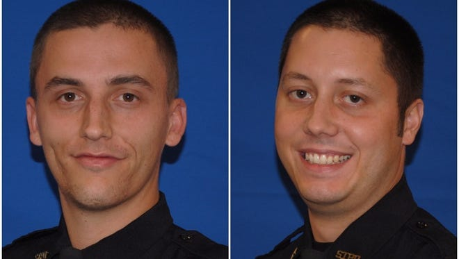 Springfield Township police officers Nick Hornback and Brandon Musgrove, from left to right.