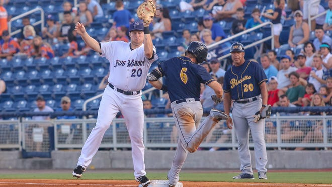 Blue Wahoos first baseman Gavin LaValley (20) reaches out to catch the ball thrown by pitcher Domingo Tapia to get out Montgomery's Grant Kay at Admiral Fetterman Field on Friday, June 30, 2017.