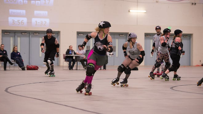 Valerie McClellan skates away from the pack during the last Electric City Roller GrrrlZ home bout at the Four Seasons Arena.