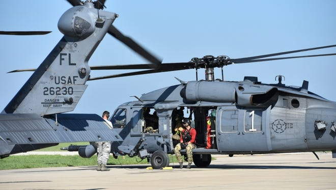 Members of the 920th Rescue Wing prepare a HH-60 Pave Hawk for flight Aug. 30 in College Station, Texas.