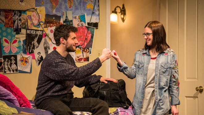 """April Paul (right) is captivated by a visiting uncle (Mark Puchinsky) in """"Russian Transport,"""" performed by Renaissance Theaterworks. The production ends its run this weekend at the Broadway Theatre Center."""