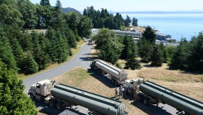 A convoy of fuel trucks prepare to depart Manchester Fuel Depot to deliver a load of aviation fuel to Joint Base Lewis-McChord during the 2017 Quartermaster Liquid Logistics Exercise (QLLEX).