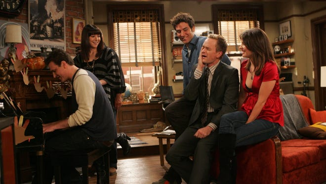 """Season 3:  """"Slapsgiving"""" -- The gang's first grown-up Thanksgiving also featured the slap bet's third strike and a celebratory song. (From left: Jason Segel, Alyson Hannigan, Josh Radnor, Neil Patrick Harris, Cobie Smulders.)  Episodic coverage of the CBS series HOW I MET YOUR MOTHER, scheduled to air on the CBS Television Network.  Photo: Monty Brinton/CBS  ¾?¬©2007 CBS Broadcasting Inc. All Rights Reserved. [Via MerlinFTP Drop]"""