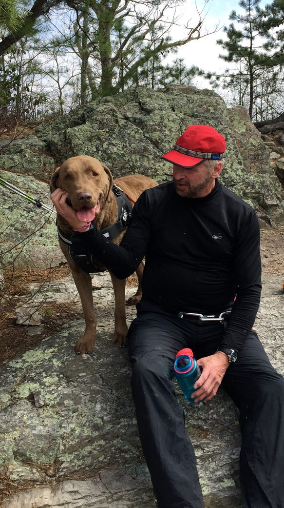 David Paulk and his dog, Abe, take a break from hiking