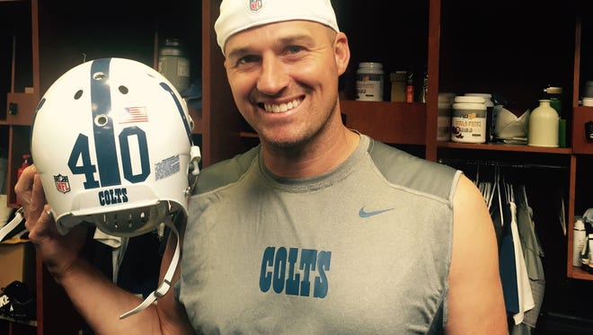 Colts backup quarterback Matt Hasselbeck turns 40 Friday. For his birthday? He wants water. He poses here with teammate Sheldon Price's No. 40 helmet.