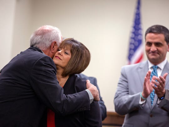 Nueces County Commissioner Carolyn Vaughn hugs her husband, Gary Vaughn, as commissioner Brent Chesney applauds following her swearing in Wednesday, March 14, 2018. Vaughn was appointed to serve on the commissioners court to replace Mike Pusley, who is running for county judge.