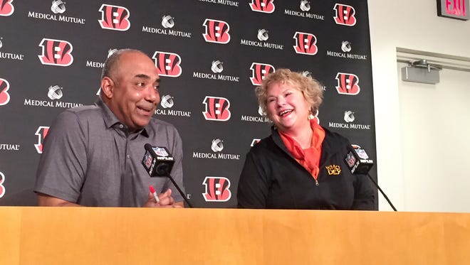 Nettie Wiethe, right, shares a laugh with Bengals head coach Marvin Lewis. Wiethe will represent the team at the NFL Draft.