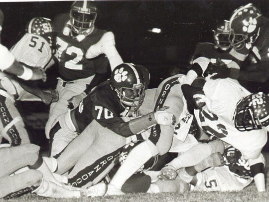 Marcus Dupree tries to break a tackle in a high school