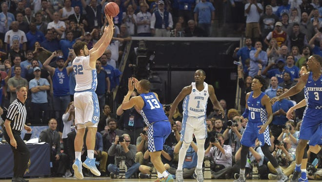North Carolina forward Luke Maye makes a basket with 0.3 seconds left to defeat Kentucky in the Midwest Regional final of the 2017 NCAA tournament.