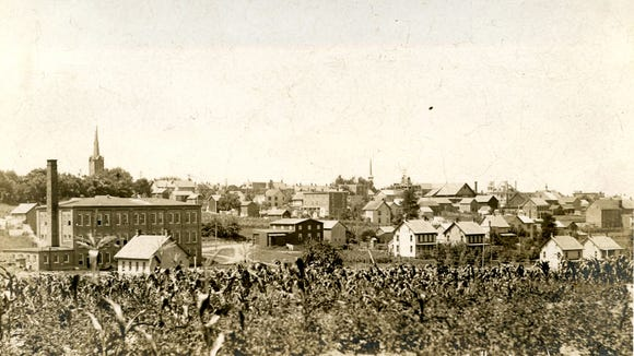 Here's a bird's-eye view of town as seen from East Clover Lane between North Park Street and Railroad Ave., near Simon's park, according to the Dallastown Historical Society. Merchant's Box factory can be seen, front left, and St. Joseph's steeple is seen behind. North Pleasant Ave runs along the left side.