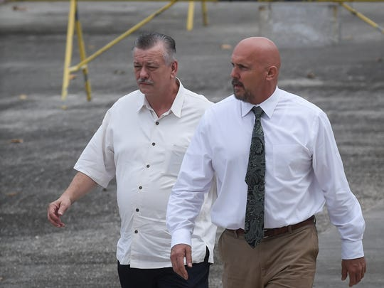 Clifford Shoemake, left, and Kimberly Conner, part owners of Guam Medical Transport, arrive for an arraignment hearing at the U.S. District Court of Guam in Anigua on Jan. 26, 2016.