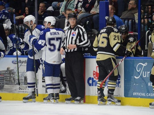 Brian Oliver, shown here working Saturday's Wilkes-Barre/Scranton at Syracuse AHL game, will be skating in Finland as a linesman at the World Junior Championship.