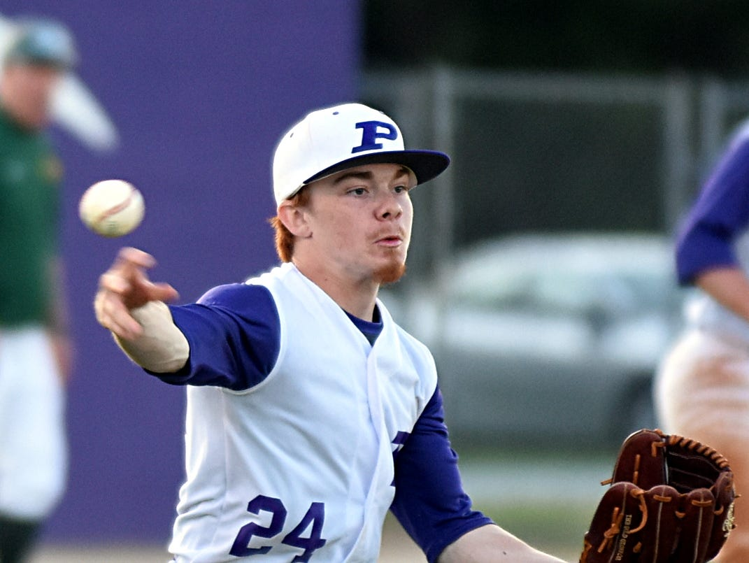 Portland High senior starting pitcher Austin Graves throws to first base for a first-inning putout.