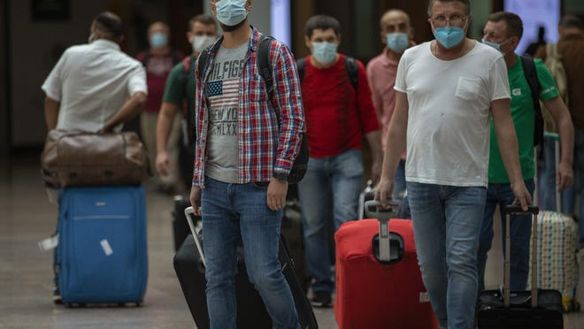 Passengers arrive at the Barcelona airport in Barcelona, Spain, Tuesday, June 30, 2020. The European Union on Tuesday is announcing a list of nations whose citizens will be allowed to enter 31 European countries. As Europe's economies reel from the impact of the coronavirus, southern EU countries like Greece, Italy and Spain are desperate to entice back sun-loving visitors and breathe life into their damaged tourism industries.