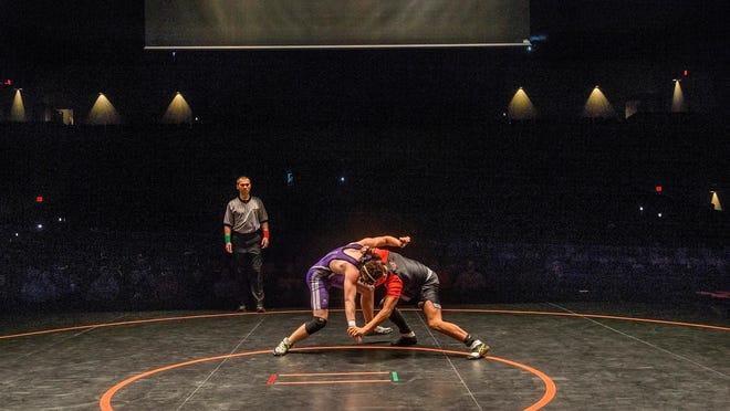 Wrestling matches begin last year in the Dubtown Throwdown on the stage at Five Points Washington.