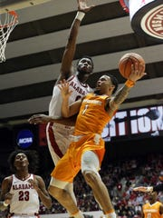 Tennessee Volunteers guard Lamonte Turner goes to the basket against Alabama Crimson Tide forward Donta Hall at Coleman Coliseum in Tuscaloosa on Feb. 10, 2018.