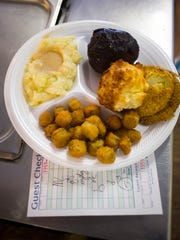 File photo: Bacon-wrapped meat loaf with fried green tomatoes, fried okra and mashed potatoes served at Horn of Plenty Restaurant in West Knoxville.