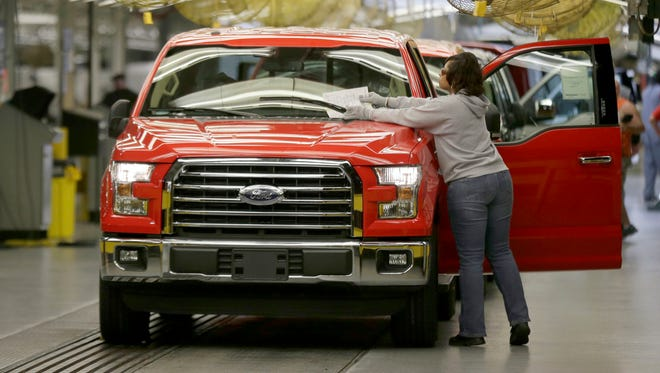 A worker inspects a new 2015 aluminum-alloy body Ford F-150 truck at the company's Kansas City Assembly Plant on Friday, March 13, 2015, in Claycomo, Mo.
