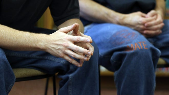 Inmates attend a Non-Violent Communication Peer Training session on Monday, July 27, 2015, at the Oregon State Penitentiary in Salem.