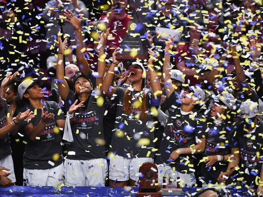 The South Carolina women's basketball team celebrates in a blizzard of confetti after winning the 2017 SEC tournament title