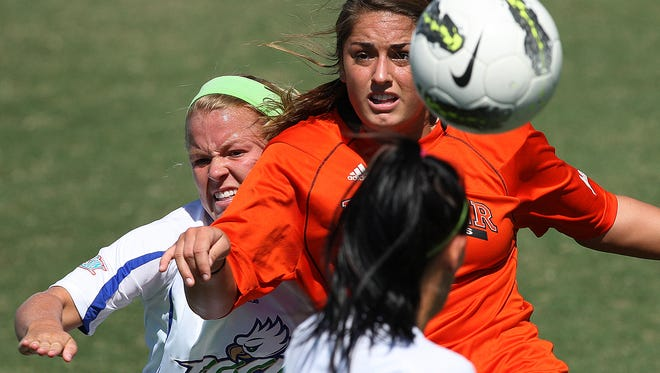 FGCU defender Emma Blackwell, left, breaks up a pass against Mercer University's Kailey Bryan during first period play Sunday (10/21/12) at FGCU in Fort Myers.