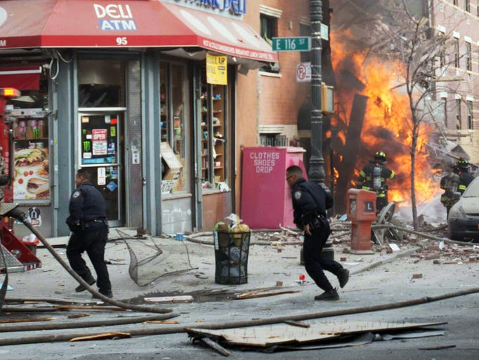 Emergency crews respond to an explosion that leveled two apartment buildings in the East Harlem neighborhood of New York on March 12, 2014.