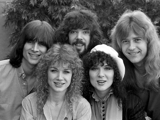 The rock group Heart pose in Los Angeles, Calif., on Feb. 19, 1980.  Bottom, left to right are Nancy and Ann Wilson.  Top row, left to right are Steve Fossen, Michael Derosier and Howard Leese.