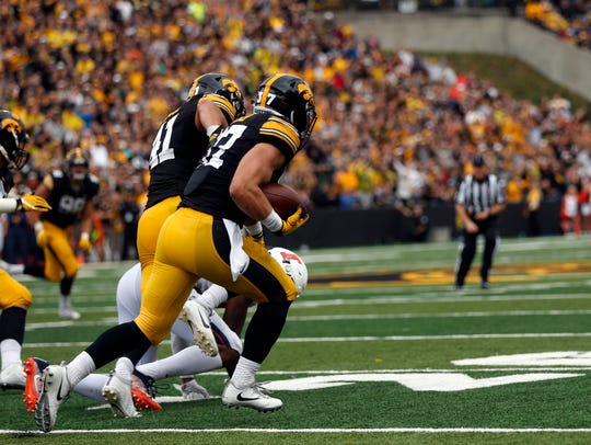 Iowa safety Brandon Snyder, shown intercepting a pass vs. Illinois in 2017 that he returned 89 yards for a touchdown, hopes to start in Week 1 for the Hawkeyes in 2018 after a second ACL surgery.