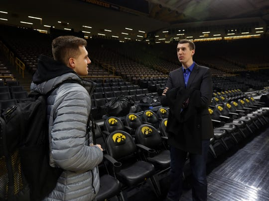 Iowa's Jordan Bohannon, left, chats with his older brother, Zach, after the Hawkeyes' game against Michigan State at Carver-Hawkeye Arena on Tuesday, Feb. 6, 2018.