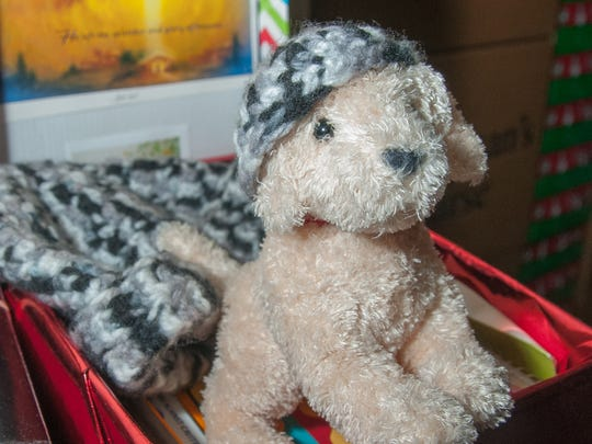 A toy dog is one several toys, school supplies and personal items to be packed into a shoe box for international distribution as part of Operation Christmas Child at the First Evangelical Free Church.