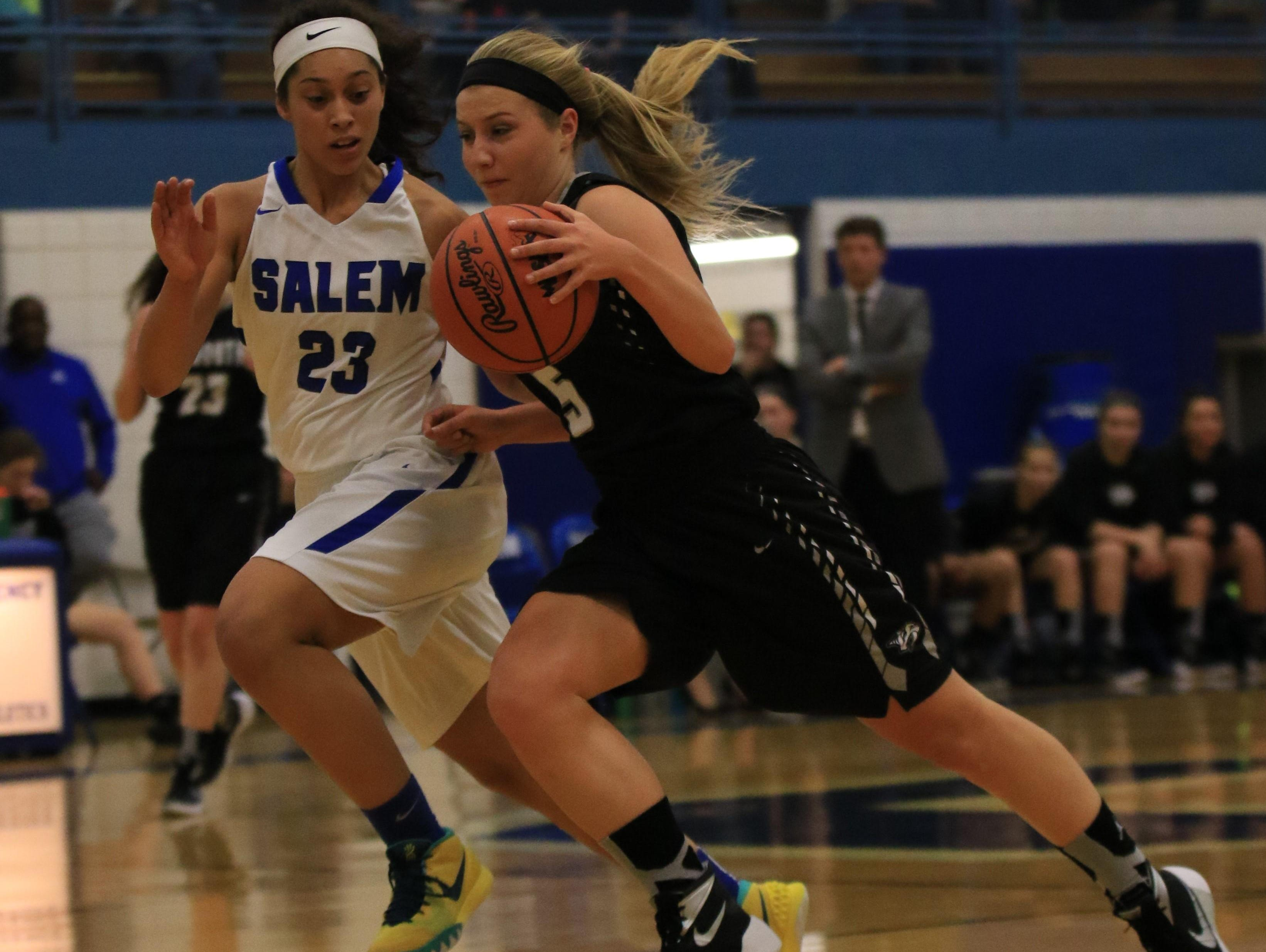 Salem's Jala Petree (No. 23) tries to close in on Plymouth's Hannah Badger (No. 5) during Tuesday's game.