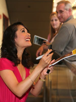 """Ali Ewoldt of Pleasantville, center, who played the slave girl Tuptim in """"The King and I"""" at Pleasantville High School in 1999, is now playing the same role on Broadway. Here she greets well wishers at the stage door, after a performance at the Vivian Beaumont Theater, Sept. 16, 2015."""