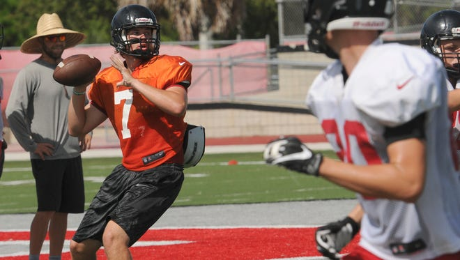 Palm Bay High QB Stuart Brown rolls out to pass during practice Wednesday.