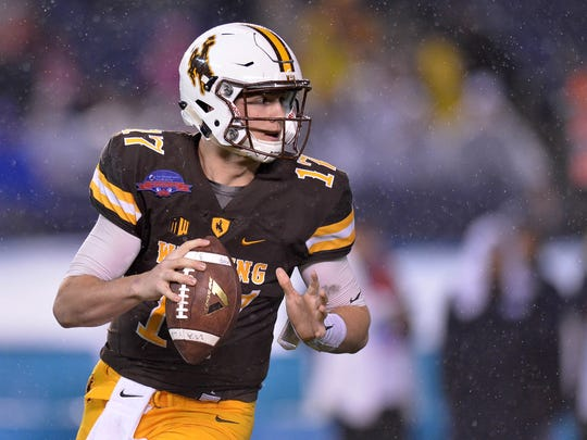 Dec 21, 2016; San Diego, CA, USA; Wyoming Cowboys quarterback Josh Allen (17) looks to pass during the second quarter against the Brigham Young Cougars at Qualcomm Stadium. Mandatory Credit: Jake Roth-USA TODAY Sports