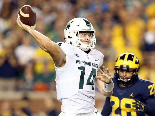 Michigan State quarterback Brian Lewerke attempts to throw the ball against Michigan during the first half at Michigan Stadium on Oct. 7, 2017 in Ann Arbor.
