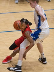 Bosse's Mekhi Lairy (2) drives around Memorial's Sam