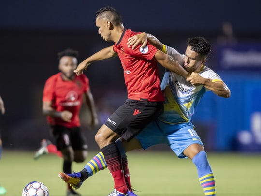 Forward Chris Cortez (9) of Phoenix Rising FC and defender Marcelo Alatorre (16) of Las Vegas Lights FC battle for the ball at Phoenix Rising FC Soccer Complex on Wednesday, June 13, 2018 in Tempe, Arizona.