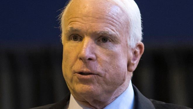 U.S. Sen. John McCain praised the state's missile-defense industry and criticized the Obama administration's emerging deal with Iran at a meeting of southern Arizona defense hawks Friday.