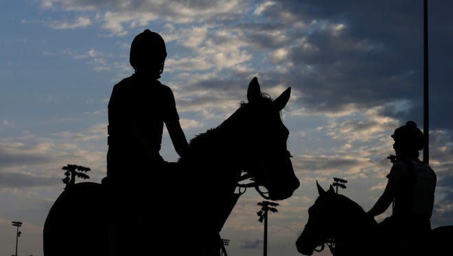 Horses work on the track during a morning workout at Churchill Downs on Friday.