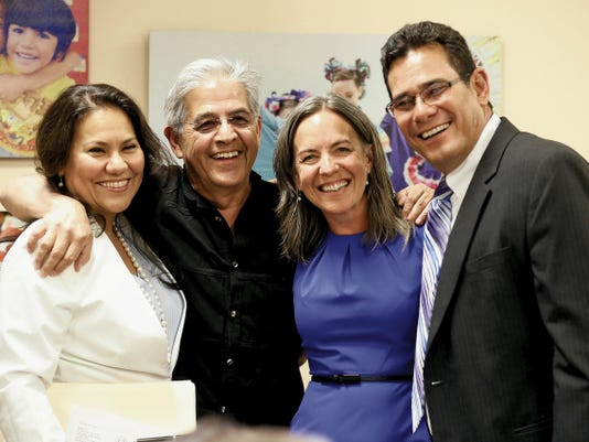 RUBEN R RAMIREZ—EL PASO TIMES County Judge Veronica Escobar, former El Paso mayor Ray Caballero, EPISD trustees Susie Byrd and Al Velarde share a moment together before swearing ceremonies at EPISD Headquarters Monday afternoon.