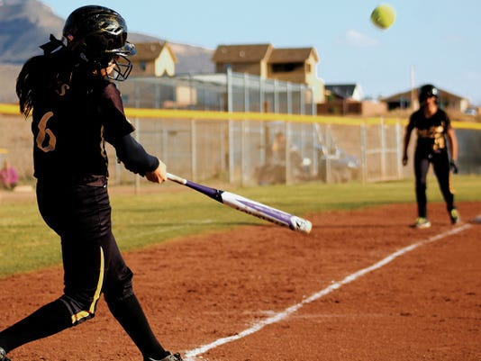 Peter Dindinger — Daily News Macie Perrin hits a ball into the outfield Friday evening at the Grady Fields.