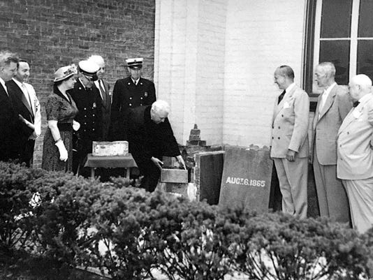 The Rev. Clair Eugene Blum, who served the Trinity United Church of Christ from 1948 to the mid-'70s, pulls out the time capsule in 1975.