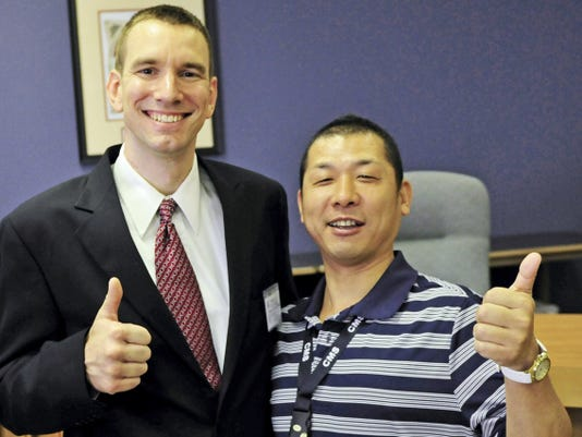 Mayor Darren Brown, left, sares a moment with Gotemba Mayor Yohei Wakabayashi, Thursday, July 16, 2015. Visitors from Gotemba, Japan met with Chambersburg Borough Council. Gotemba is Chambersburg's sister city. Visitors are on tour at locations around the borough.