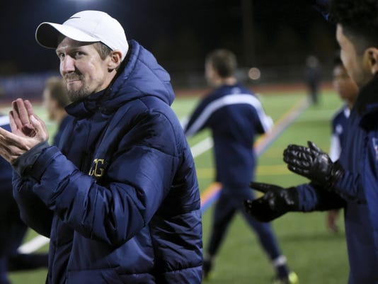 Chambersburg first-year coach Corey Grove celebrates a win against Hempfield on Tuesday in the first round of the District 3 Class AAA playoffs.